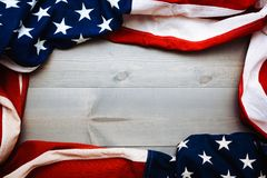 The flag of the United Sates on a grey plank background with copy space stock images