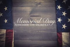The flag of the United Sates on a grey plank background with memorial day. The flag of the United Sates of America on a grey plank background with memorial day stock image