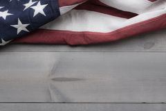 The flag of the United Sates on a grey plank background with copy space stock photography