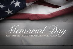 The flag of the United Sates on a grey plank background with memorial day. The flag of the United Sates of America on a grey plank background with memorial day stock photo