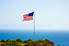 Flag of the United States. American flag on the hill close to the ocean Royalty Free Stock Photos