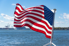 Flag of the United States of America at the back of a ship Royalty Free Stock Image
