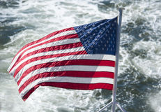 Flag of the United States of America at the back of a ship Stock Images