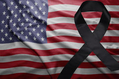 Flag of united states of america with black mourning ribbon. Waving national flag of united states of america with black mourning ribbon Stock Images