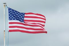 The American flag blows in the wind. The flag of the United States Of America blows in the wind Royalty Free Stock Image