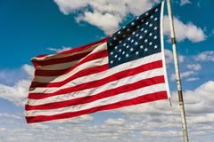 American national flag in front of Boston sky Stock Image