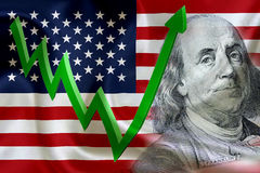 Flag of the United States of America with the face of Benjamin Franklin. On US dollar 100 bill and a green arrow indicates the stock market enter booming period royalty free stock photography