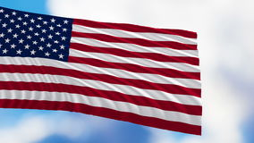 Flag Of The United States Of America. Fluttering in the wind against a cloudy sky stock footage