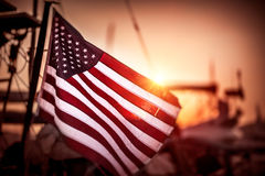 Flag of United States of America. Flutters in the winds in mild sunset light, independence day of America Stock Photo