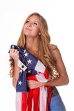 Flag of United States of America in hands of beautiful woman. Stock Image