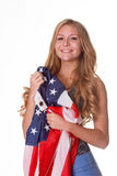 Flag of United States of America in hands of beautiful woman. Stock Photos
