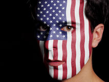 Flag of United States of America. Painted on a Face of a Young Man Royalty Free Stock Image