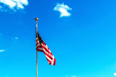 Flag of United States of America with sky. Stock Photos
