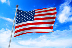 Flag of United States of America USA developing against a blue sky. Flag of United States of America USA developing against a clear blue sky Royalty Free Stock Image