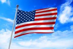 Flag of United States of America USA developing against a blue sky. Flag of United States of America USA developing against a clear blue sky royalty free stock image