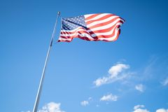 American flag against the blue sky stock images