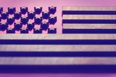 The flag of the United States is close to the tree, in pink tones royalty free stock photography