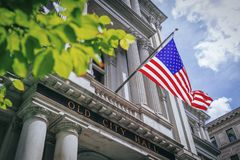 US Flag Flying over Old City Hall in Boston stock photography