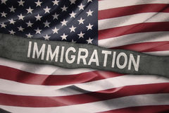 Flag of United States with Immigration word Stock Photo