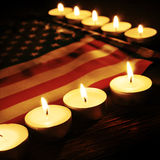 Flag of the United States and lighted candles royalty free stock images
