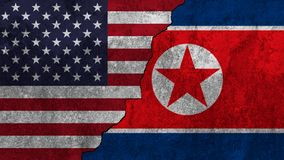 Flag of United states and North Korea. Flag of United states and North Korea painted on wall background Stock Images