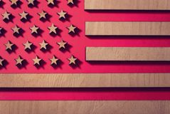 Flag united states on a red background of wood, smoked royalty free stock photo