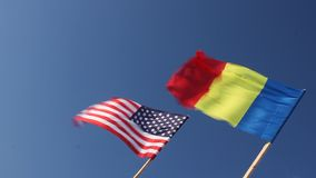 Flag of the United States and Romania. Waving in the wind stock video footage