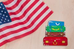 Flag of the United States, word emigration in abstract letters. Wooden background stock photography