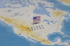 The Flag of the United States in the world map stock photography