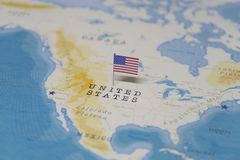 The Flag of the United States in the world map stock image