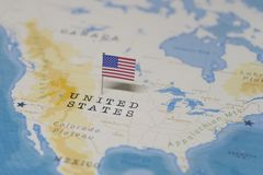 The Flag of the United States in the world map royalty free stock image