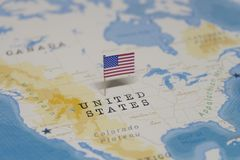 The Flag of the United States in the world map stock photo