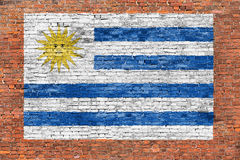 Flag of Uruguay painted on brick wall. Flag of Uruguay painted on old brick wall Stock Photos
