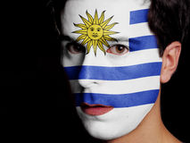 Flag of Uruguay. Painted on a Face of a Young Man Stock Photos