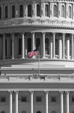 Flag On The Us Capital Building. American flag waving on the United States Capital Building Royalty Free Stock Image