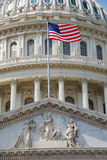 Flag with US Capitol Building, Washington DC. US national flag flying in front of US capitol Building in Washington DC Stock Image