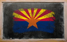 Flag of US state of arizona on blackboard painted with chalk. Chalky american state of arizona flag painted with color chalk on old blackboard Royalty Free Stock Photography
