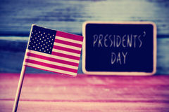 The flag of the US and the text presidents day in a chalkboard Stock Photos