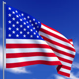 Flag USA. The American flag flies on a background of blue sky Stock Image