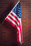 Flag of the USA. Before brick wall royalty free stock photo