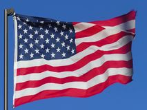 Flag of USA. Flag of USA fluttering in the wind on a background of blue sky stock video