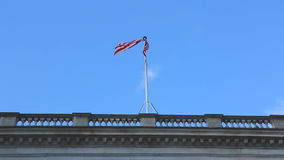 Flag USA. USA Flag Flying at Top of Building stock video