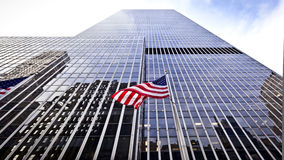 Flag of the USA in front of the office building. Flag of the United States of America in front of the office building Stock Photography