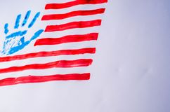 Flag of the USA, hand, on a white background stock photo
