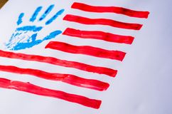 Flag of the USA, hand, on a white background stock photography