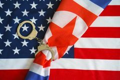 Flag of USA and North Korea. Handcuffs. Sanctions. North Korea flag in handcuffs on the background of the American flag. US sanctions against North Korea. flag royalty free stock photo