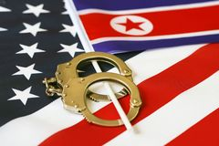 Flag of USA and North Korea. Handcuffs. Sanctions. North Korea flag in handcuffs on the background of the American flag. US sanctions against North Korea stock images