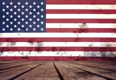 The flag of USA on a wall of plaster and the floor. The flag of USA on a wall of plaster and the wooden floor stock photos