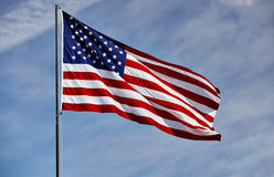 Flag USA in wind on flagpole with sky Royalty Free Stock Photos