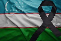 Flag of uzbekistan with black mourning ribbon. Waving national flag of uzbekistan with black mourning ribbon Stock Photography